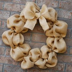 burlap wreath... Going to make this for the hospital room door since we don't know if it is a boy or a girl. Will make pink and blue bows and someone can tie the correct color on once the baby is born. Will buy wooden hearts and put boys name on one and girls name on other.