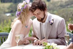 Kiss on the temple while signing the marriage certificate :)