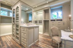 The woman's closet with windows and a marble topped vanity. Love this!!!
