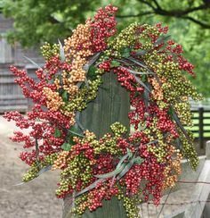 Bountiful Berry Wreath - Bliss - A twist on the Classic Berry Wreath in shades of red, green melon, and bittersweet - Complemented by wild grass and green leaves - Built on a sturdy grapevine base - V