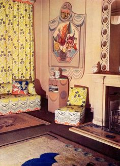 Music Room by Duncan Grant and Vanessa Bell for the Lefevre Galleries in London, 1932. The theme was Autumn and the walls were decorated with six flower panels, each incorporating a mirror. Other decorations included rugs, curtains, needlework panels on the chairs, lamps and cushions. Even the piano was painted by Duncan, repeating the pattern of leaves used elsewhere in the room.