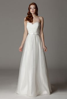 Brides: Aria. Sweetheart strapless wedding gown with fabric covered belt and a silk organza skirt. Made in USA