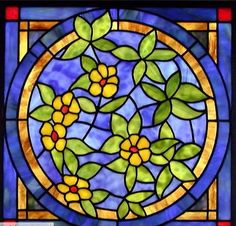 CIRCULAR STAINED GLASS WINDOW.