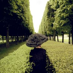 rodney smith photos | Rodney Smith , Woman with hat between hedges , Parc De Sceaux, France ...