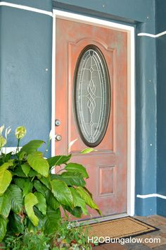 Tutorial to paint an aged copper patina. I painted my front door to look nautical with a rich patina of aged copper. It looks just like real copper! H2OBungalow.com #frontdoor #fauxpaint #copperpatina