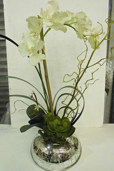 White orchids in chrome vase