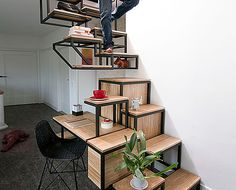 Mieke Meijer's Clever Suspended Staircase Doubles as a Storage System