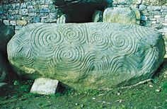 a Celtic and pre-Celtic spiral symbol found on a number of Irish Megalithic and Neolithic sites like this Newgrange entrance stone
