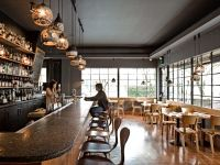Heather Levine pendant lamps over the bar at Wildwood in Portland, OR