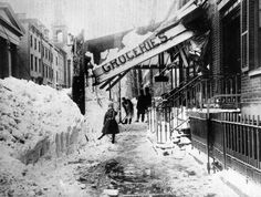 Blizzard of March 12-14, 1888 (21 inches) The awning of a grocery store is damaged from the weight of the snow during the blizzard of 1888 in New York City. The blizzard on March 12-14 paralyzed the city with winds that reached up to 60 miles per hour, creating drifts as high as fifty feet.