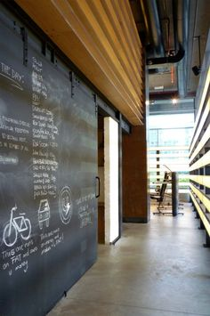 Like the large chalkboard barn door idea for a nutrition/health club----Uenergy Health Club / GAJ Architects Uenergy Health Club / GAJ Architects – ArchDaily Gym Interior, Interior Architecture, Interior And Exterior, Cool Office, The Office, Office Decor, Office Ideas, Commercial Design, Commercial Interiors