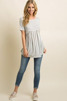Grey Striped Crisscross Back Peplum Top A striped peplum top featuring a low back with crisscross accent, short sleeves, and a rounded neckline. This style was created to be worn before, during, and after pregnancy. Fall Maternity Outfits, Maternity Sewing, Stylish Maternity, Maternity Wear, Maternity Tops, Maternity Fashion, Peplum Top Outfits, Peplum Tops, Moda Formal