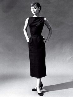 Coco Chanel Little Black Dress from the 1920s. It shows a modest high neck that goes straight across from shoulder to shoulder and hits at the natural waistline. This creates a very feminine look and in a way it demands respect. There are many similar style black dresses in todays fashion that show similar design details and are popular in the workplace. 2/23/16