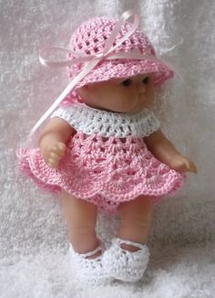 """This pattern is for a short dress with bonnet, knickers and shoes made in fine crochet cotton for your 5"""" baby doll"""