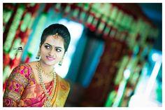 South Indian bride. Temple Indian bridal jewelry. Jhumkis.Red silk kanchipuram sari.Braid with fresh jasmine flowers. Tamil bride. Telugu bride. Kannada bride. Hindu bride. Malayalee bride.Kerala bride.South Indian wedding.