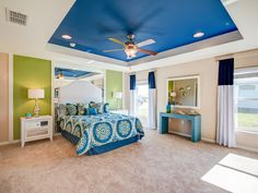This beautiful master bedroom suite features a stylish tray ceiling and plenty of natural lighting. Highland Homes' Serendipity model home in Davenport, Florida. Click to see more photos of this beautiful home!