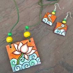 Buy Mural Necklaces, Mural Art Necklaces, Kerala Mural necklaces, Handcrafted Neckalces, Goddess Painted Necklaces at CraftsandLooms. Terracotta Jewellery Making, Terracotta Jewellery Designs, Wooden Bead Necklaces, Art Necklaces, Teracotta Jewellery, Kerala Mural Painting, Fabric Jewelry, Clay Jewelry, Jewlery