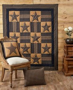 Use our Teton Star Quilted Throw in a practical way or make artwork out of it by hanging it on the wall. https://www.primitivestarquiltshop.com/products/teton-star-quilted-throw #primitivequiltedthrows