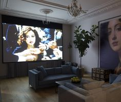Krudy Luxury Apartment Budapest - the huge screen and project is there for you to make a private movie night in the lounge
