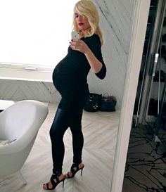 Gwen Stefani ROCKS her big baby bump in black skin-tight dress + leggings + heels