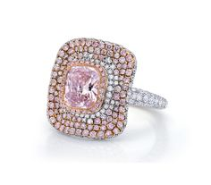 A new design from Martin Katz - a ring set with a fancy pink cushion-cut diamond.