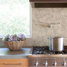 limestone backsplash, honed quartz countertop, eucalyptus cabinetry with horizontal grain