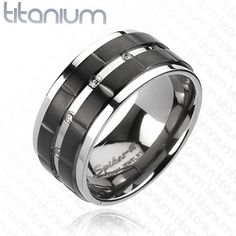 This is totes Justin's unique style - men's titanium ring/wedding band maybe