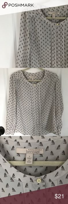 Banana Republic blouse Used but in great condition Banana Republic blouse - heritage. Ivory with cute penguin print. 100% polyester Banana Republic Tops Blouses