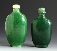 "Two Porcelain Snuff Bottles. Green glaze, elongated ovate flattened flask, some roughness to bottom, Ht. 3 1/2""; Green over glaze, some roughness to bottom, Ht. 3""."