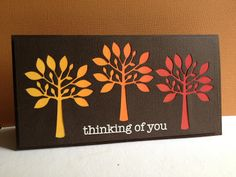 handmade greeting card .... short and wide (#10) layout ... three negative space die cut trees ... dark chocolate base ... backing paper in an ombré color wave from golden yellow to rusty brown ... great card for Autumn ... Simon Says Stamp die ...