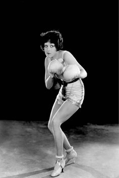 1920's female boxer.  Gotta love the shoes.