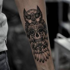 sugar skull and owl tattoo on forearm by @fredrikazootattoo