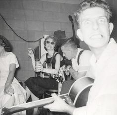 Suburban beatniks in midst of late night basement jam session with shades and cigarettes and guitars and booze. 1950s vernacular photo snapshot