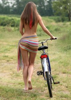 Chicks and bikes Take a ride in to the forest.
