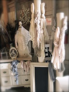 great way to display scarfs. Could use pillars, wood or pvc pipe with heavy base to hold sturdy.