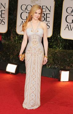 Nicole Kidman, one of the night's presenters, shows her sexy side in a studded bodycon gown by Versace.