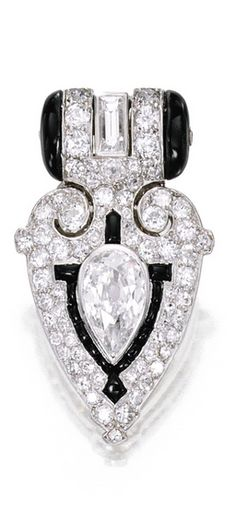 Platinum, Onyx and Diamond Clip-Brooch, Cartier The geometric plaque centering a pear-shaped diamond weighing approximately 1.60 carats, accented by baguette, old European and single-cut diamonds weighing approximately 4.25 carats, highlighted with onyx accents, signed Cartier, numbered 863153 A and 7074; circa 1925.