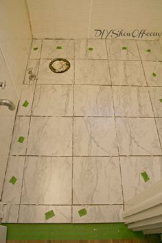 Apartment DIY progress: tiling the bathroom floor (before