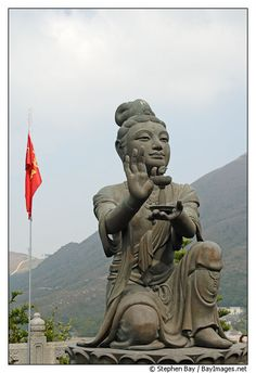 Buddhist statues praising the Tian Tan Budha. Lantau Island, Hong Kong, China.