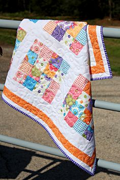 Love the fabrics in this quilt:-)