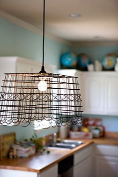 diy anthropologie inspired pendant lamp tutorial on poppytalk by ashley ann of under the sycamore Diy Luz, Under The Sycamore, Diy Luminaire, Basket Lighting, Lighting Ideas, Unique Lighting, Metal Baskets, Diy Décoration, Lampshades