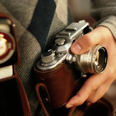 Fancy - Leather Camera Case. I don't know about the camera case, but the Leica camera and Carl Zeiss lens is about as good as it gets and if you can still find one (used on ebay or camera shop) I highly recommend it. You can be the next Ansel Adams!