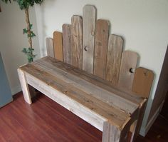 A simple bench with a staggered back and made from reclaimed wood.