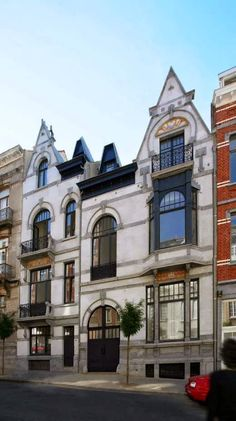 BELGIUM HOME ARCHITECTURE COMBINES TWO ART NOUVEAU HOUSES INTO ONE STAND-OUT STRUCTURE IN THE CITY - This Craftsmanship Nouveau house arrangement designed by Cedric Meuris and Bernard Devaux is as moving as it is roused. Look at it! This Brussels, Belgium home joins two Craftsmanship Nouveau houses into one