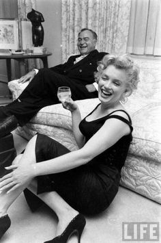 Marilyn during a meeting with producer Kermit Bloomgarden in her New York apartment, 1958.