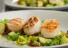 Gluten-Free grilled scallops served over Brussels sprouts. This great recipe only takes 30 minutes to make. Try it today.