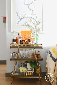 Give guests the option to serve themselves with this bar cart.  Alcohol and everyone will have a good time. We promise.