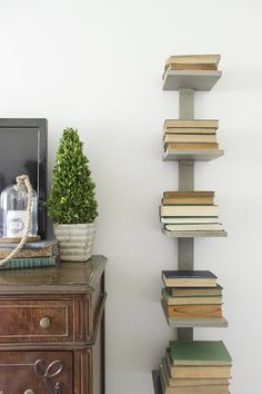 How to make a space-saving and sturdy spine bookshelf using only 2 boards, that will add extra storage and an eye-catching display for books. Bookshelves For Small Spaces, Wall Bookshelves, Furniture For Small Spaces, Wall Shelves, Bookshelf Diy, Book Shelves, Shelving, Bookcase, Vertical Bookshelf