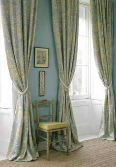 So pretty - large windows with floor to ceiling drapes that match the wall color