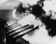 USS South Dakota (BB-57) fires her forward 16/45 guns at Kamaishi targets during the bombardment. 14 July 1945.